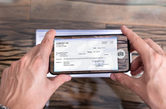 Check being scanned by a cell phone via a mobile banking app